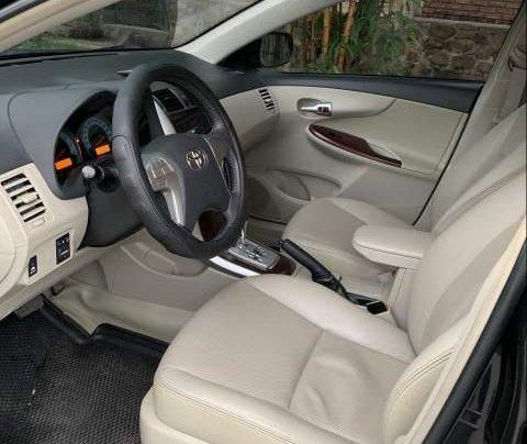 Cần bán gấp Toyota Corolla altis đời 2012, màu đen còn mới3
