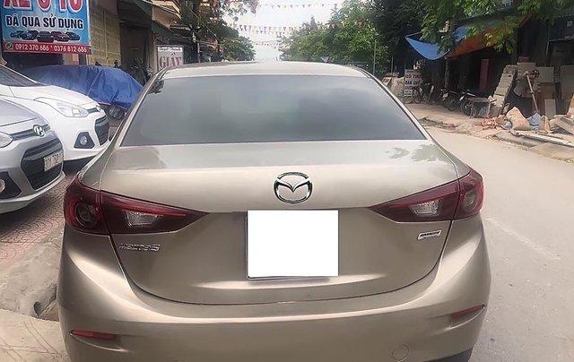 Bán Mazda 3 năm sản xuất 2015 xe gia đình1