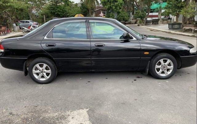 Cần bán gấp Mazda 626 đời 1998, màu đen giá cạnh tranh0