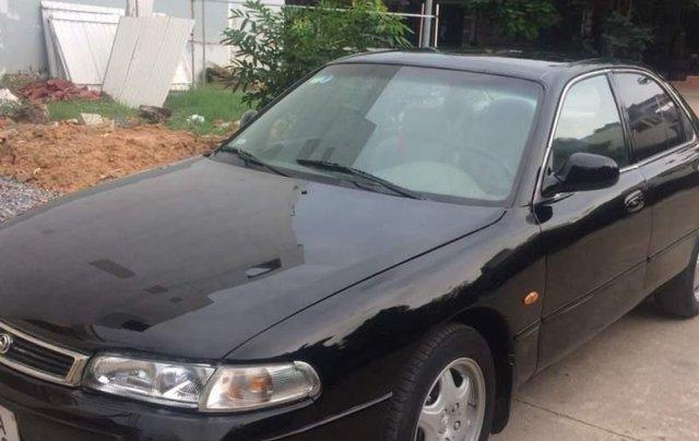 Cần bán xe Mazda 626 đời 1993, màu đen0