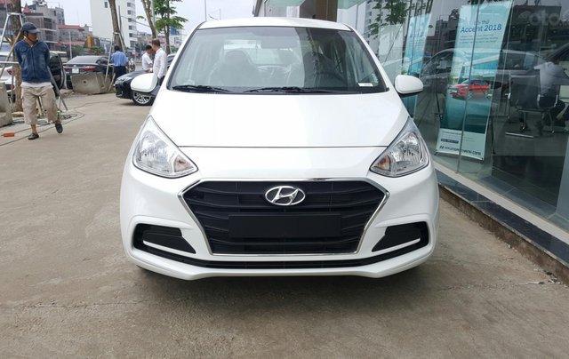 Bán Hyundai Grand I10 sedan Base trắng giao ngay, lấy xe chỉ với 120tr, hỗ trợ đăng ký Grab! LH: 0903 17 53 122