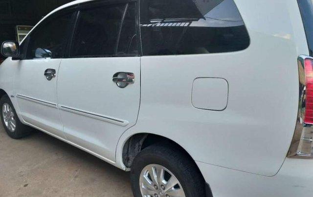 Cần bán Toyota Innova G 2010, màu trắng xe gia đình, giá 325tr0