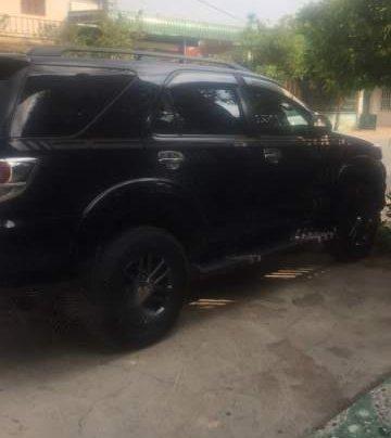 Cần bán xe Toyota Fortuner 4x2AT đời 2015, màu đen1