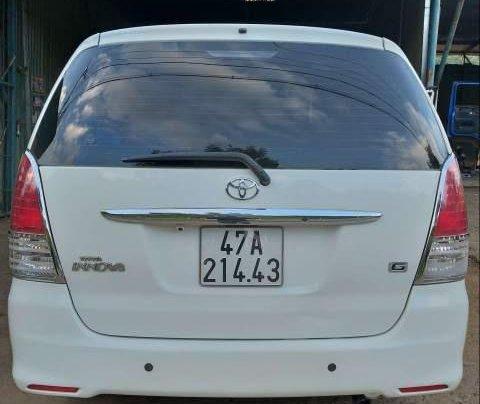 Cần bán Toyota Innova G 2010, màu trắng xe gia đình, giá 325tr3