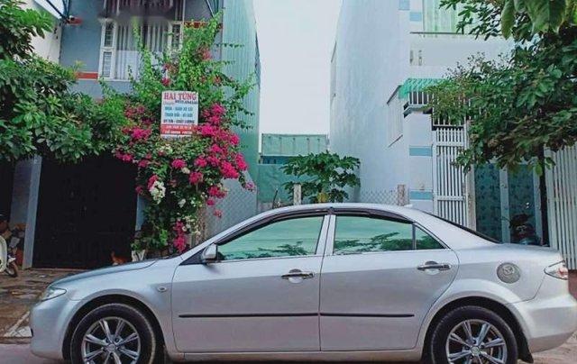Cần bán gấp Mazda 6 năm sản xuất 2004, màu bạc, nhập khẩu0