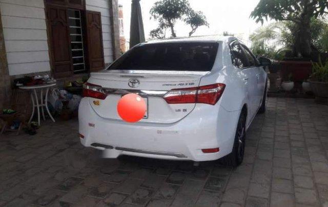 Bán Toyota Corolla altis 1.8G AT năm 2015, màu trắng số tự động2