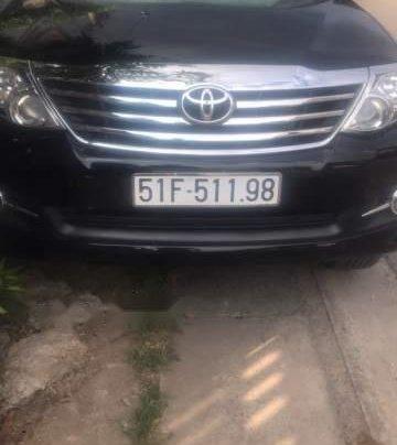 Cần bán xe Toyota Fortuner 4x2AT đời 2015, màu đen0