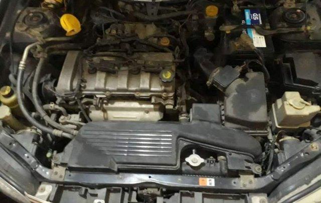 Bán Ford Laser sản xuất 2004, màu đen, nhập khẩu  4