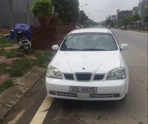 Bán lại xe Daewoo Lacetti sản xuất 2005, màu trắng, xe nhập xe gia đình0
