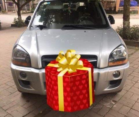 Cần bán gấp Hyundai Tucson đời 2009, màu bạc, nhập khẩu0