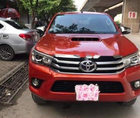 Bán gấp Toyota Hilux AT sản xuất năm 2016, xe chính chủ0
