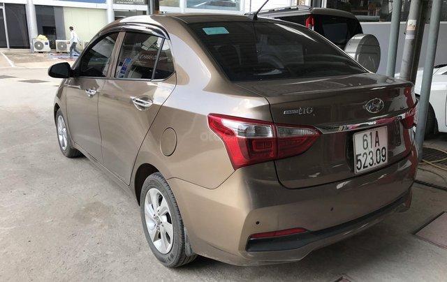 Bán Hyundai Grand i10 sedan 1.2MT màu nâu titan, số sàn, bản đủ, sản xuất 20182