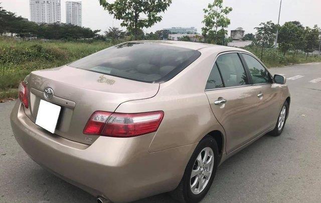Nhà cần tiền bán gấp xe Toyota Camry LE đời 2007, số tự động, màu nâu vàng7