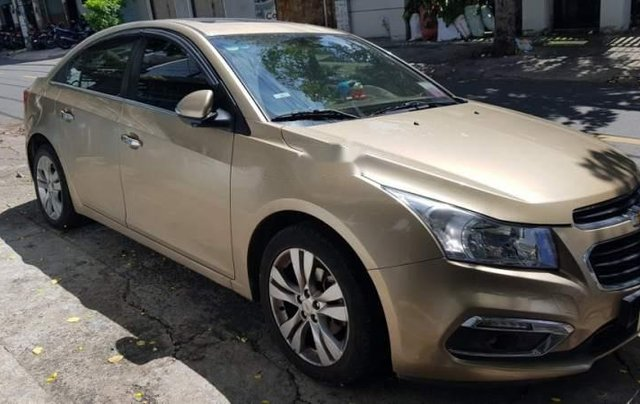 Bán xe Chevrolet Cruze 1.8  LTZ sản xuất năm 2015, màu vàng, nhập khẩu 0