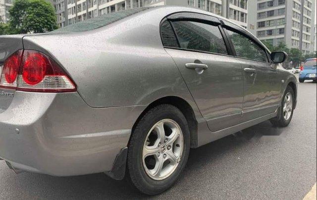 Cần bán Honda Civic 1.8 AT 2009, màu xám chính chủ, 348tr4