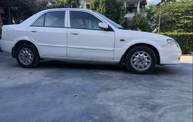 Gia đình bán xe Mazda 323 năm 2001, màu trắng, giá chỉ 155 triệu0