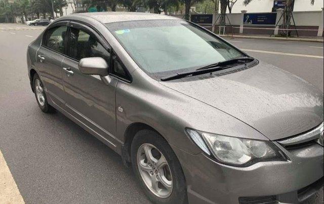 Cần bán Honda Civic 1.8 AT 2009, màu xám chính chủ, 348tr0