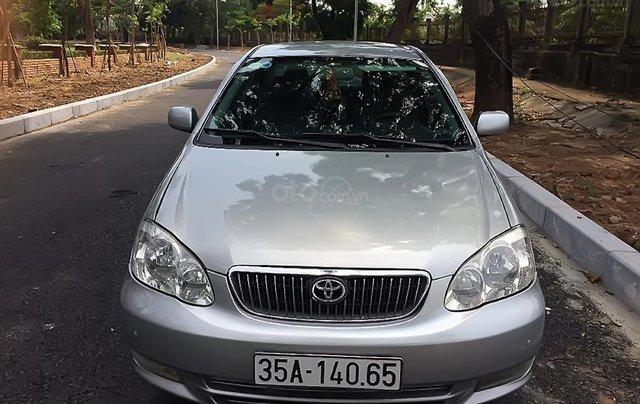 Chính chủ bán Toyota Corolla altis năm 2002, màu bạc0