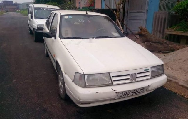 Cần bán lại xe Fiat Tempra sản xuất năm 1997, màu trắng, kính điện, vành đúc0