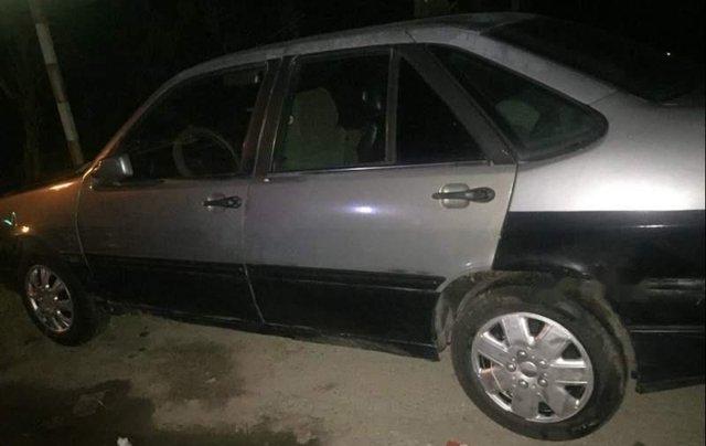 Cần bán gấp Fiat Tempra sản xuất năm 1997, màu bạc0