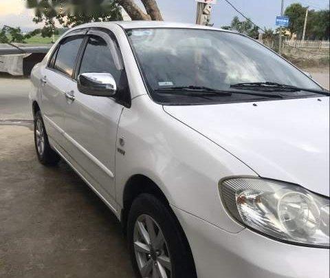 Bán Toyota Corolla 2003, màu trắng còn mới, giá tốt0