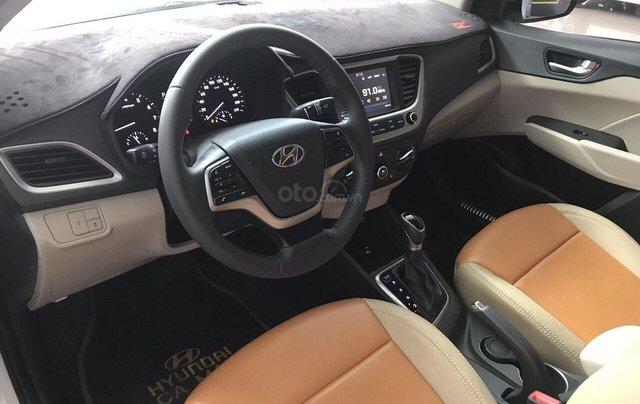 Bán Hyundai Accent 1.4AT màu trắng, số tự độn, g sản xuất 2018, bản tiêu chuẩn đi 16000km6