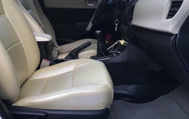 Gia đình cần bán xe Altis 2015, số sàn, màu trắng3