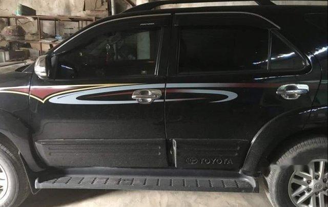 Bán xe Toyota Fortuner sản xuất 2013, màu đen, xe ít dùng bảo dưỡng đầy đủ còn rất đẹp0