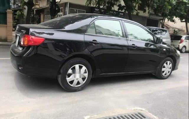 Bán Toyota Corolla đời 2009, màu đen, rất ít trầy xước1