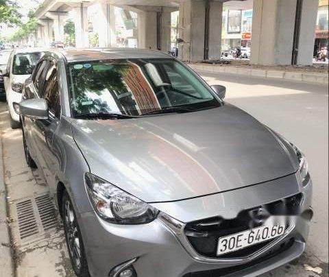 Bán xe Mazda 2 sản xuất 2015, màu xám, xe đi giữ gìn cẩn thận0