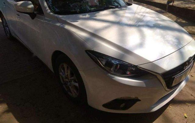 Cần bán gấp Mazda 3 HB đời 2016, màu trắng, đăng ký lần đầu 20161