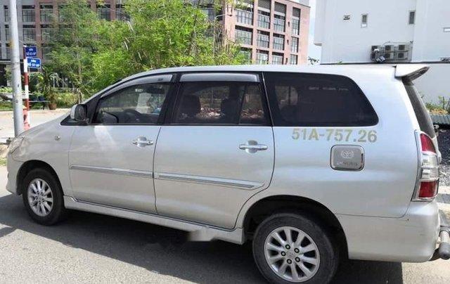 Cần bán xe Toyota Innova MT sản xuất 2013, giấy tờ đầy đủ, máy móc êm, hơi xước nhẹ1