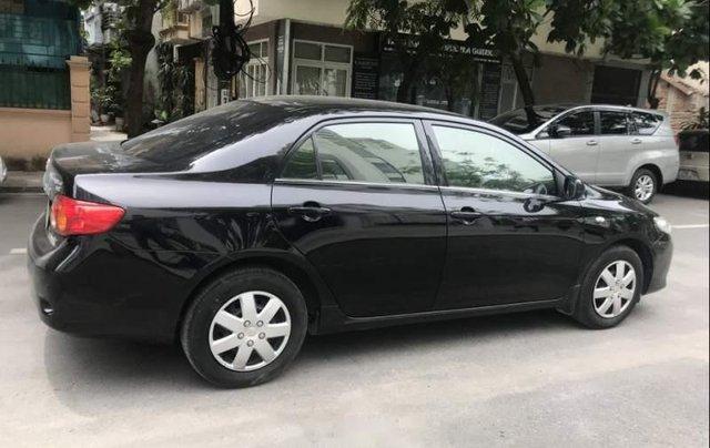 Bán Toyota Corolla đời 2009, màu đen, rất ít trầy xước2