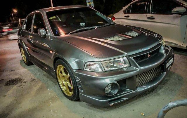 Cần bán xe Mitsubishi Lancer 1.6 MT, màu xám chính chủ0