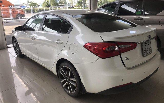 Bán Kia K3 1.6AT màu trắng, sản xuất 2016 biển Sài Gòn đi 33000km, xe đẹp7