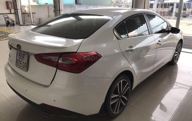 Bán Kia K3 1.6AT, màu trắng, 2016, biển SG, xe gia đình đi2