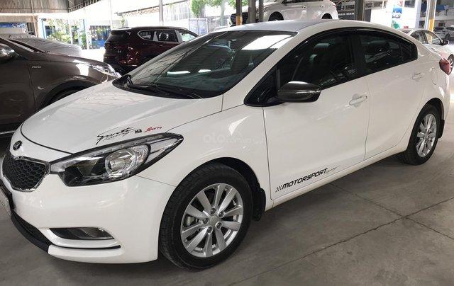 Bán Kia K3 1.6MT màu trắng số sàn sản xuất 2015 biển Sài Gòn đi đúng 34000km xe đẹp chuẩn6