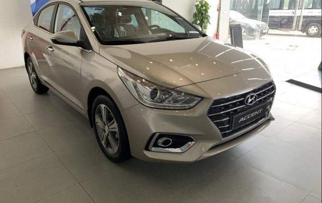Bán Hyundai Accent 1.4AT sản xuất năm 2019, màu vàng cát0