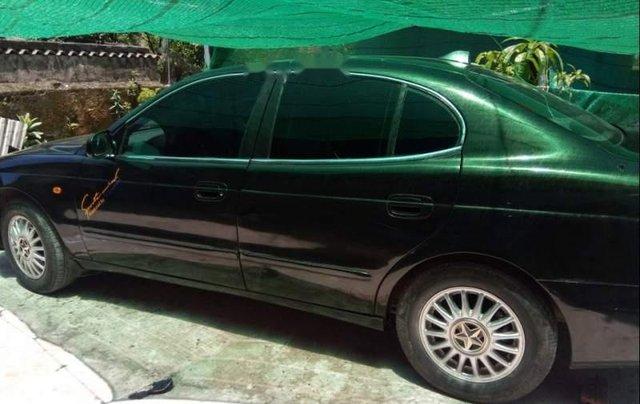 Cần bán Daewoo Leganza MT sản xuất 2001, màu đen, xe còn nguyên bản, máy êm1