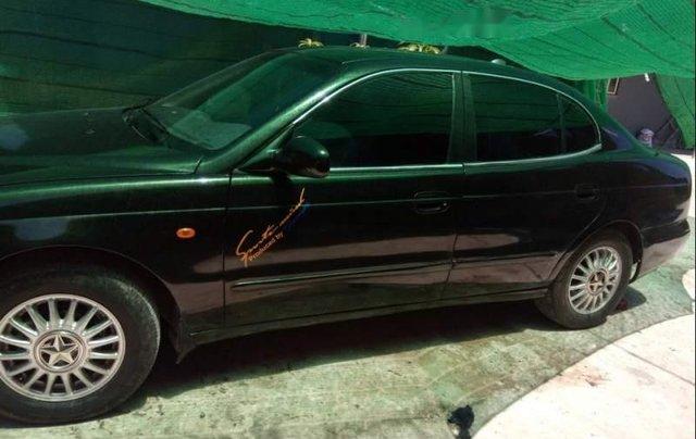 Cần bán Daewoo Leganza MT sản xuất 2001, màu đen, xe còn nguyên bản, máy êm0