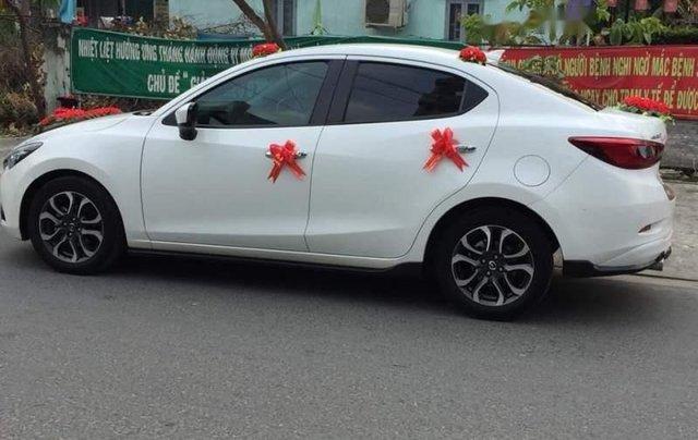 Cần bán Mazda 2 AT sản xuất 2017, màu trắng, xe nhà mình mua mới 7/20170