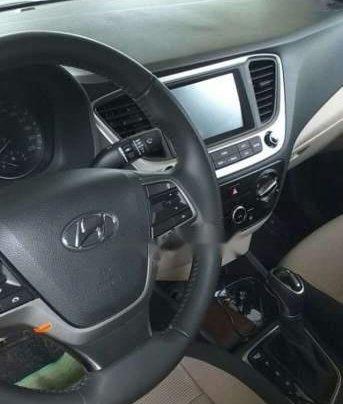 Cần bán xe Hyundai Accent đời 2019, màu trắng, 5 chỗ1