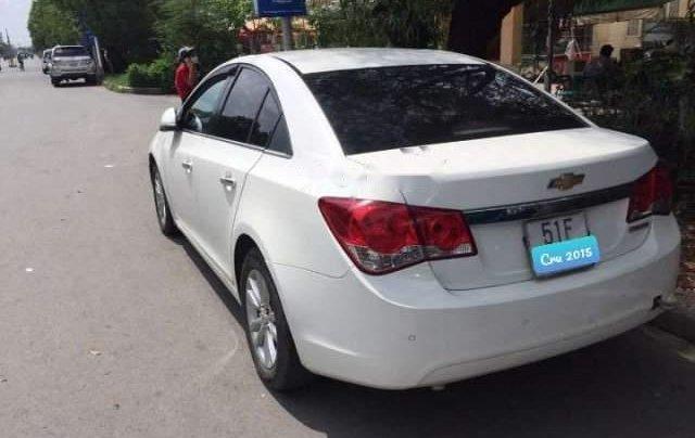 Cần bán xe Chevrolet Cruze MT sản xuất 2015, màu trắng, xe một chủ mua mới từ đầu2