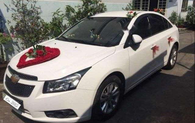 Cần bán xe Chevrolet Cruze MT sản xuất 2015, màu trắng, xe một chủ mua mới từ đầu0