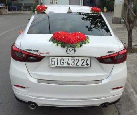 Cần bán Mazda 2 AT sản xuất 2017, màu trắng, xe nhà mình mua mới 7/20172