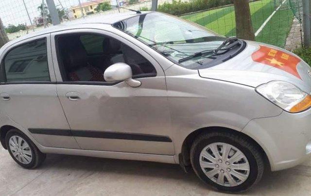 Cần bán lại xe Chevrolet Spark năm 2012, màu bạc0