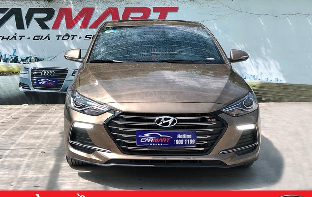 Cần bán Hyundai Elantra Tubor Sport 1.6 AT năm 2018, màu nâu0