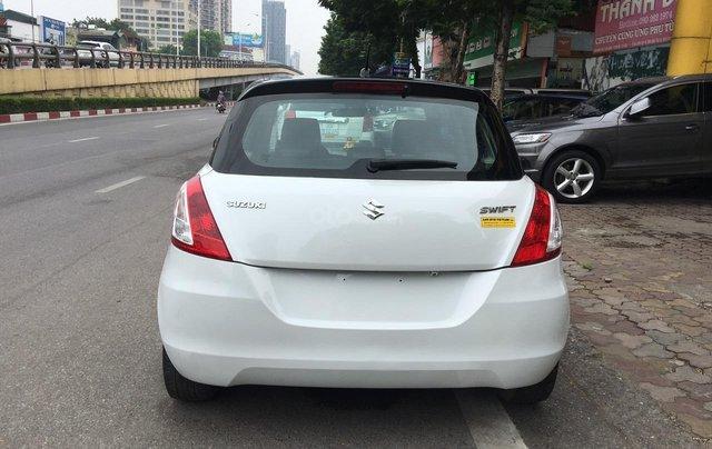 Cần bán xe Suzuki Swift 1.4AT sản xuất 2013, màu trắng, nhập khẩu1