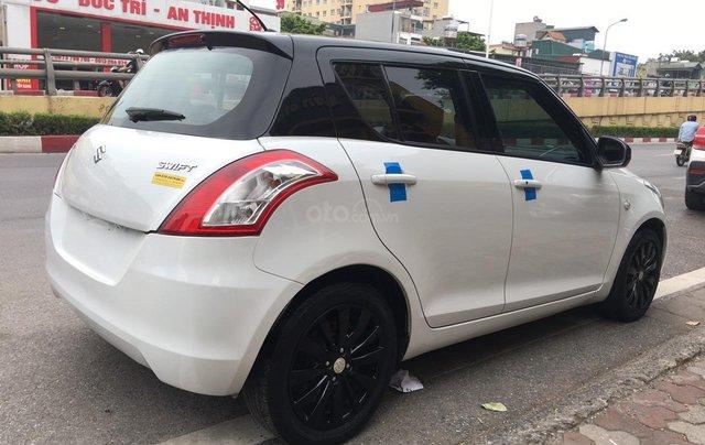 Cần bán xe Suzuki Swift 1.4AT sản xuất 2013, màu trắng, nhập khẩu5