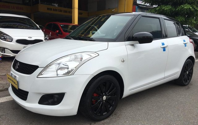 Cần bán xe Suzuki Swift 1.4AT sản xuất 2013, màu trắng, nhập khẩu7